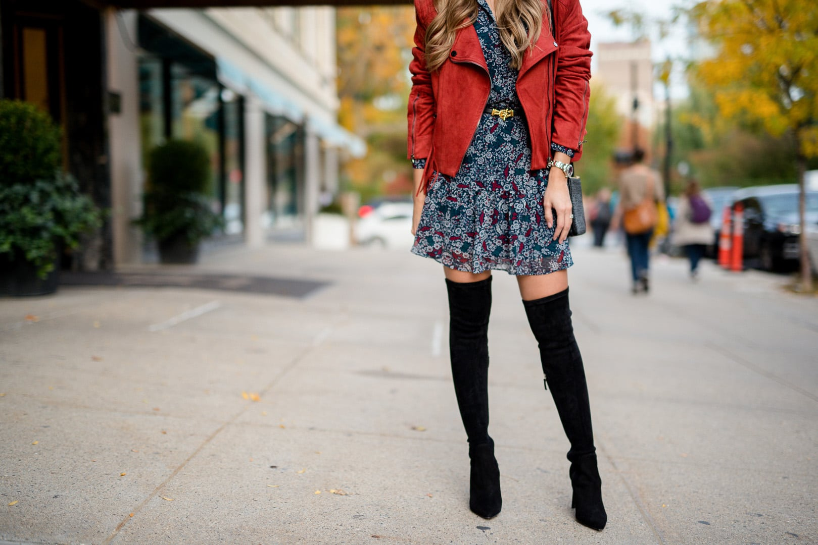 Pam Hetlinger wearing a suede fringed jacket, floral dress and Delman over-the-knee boots
