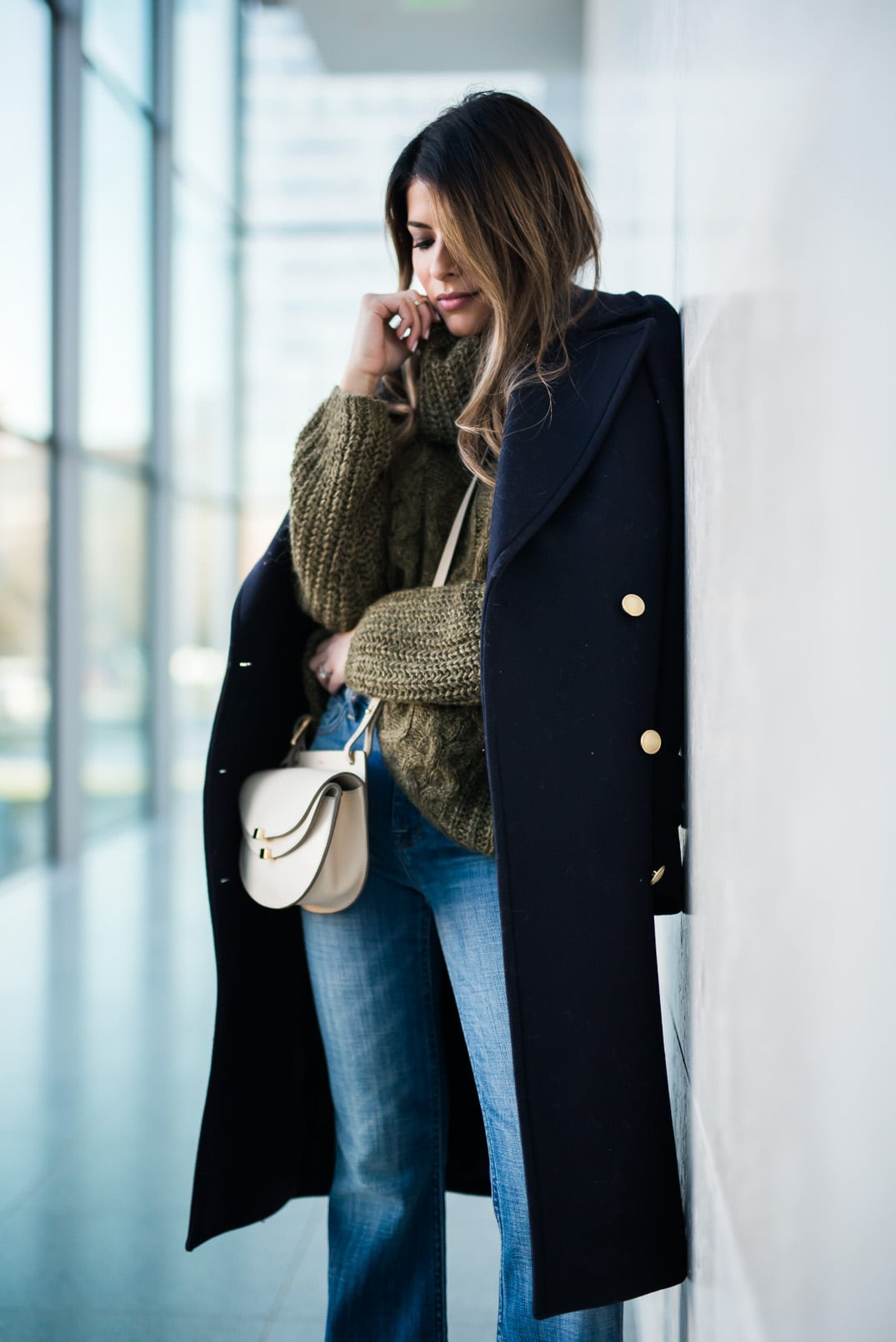Pam Hetlinger, The Girl From Panama wearing a Khaki sweater, h&m navy coat, 7 for all mankind ginger jeans, gray booties, and chloe georgia bag.