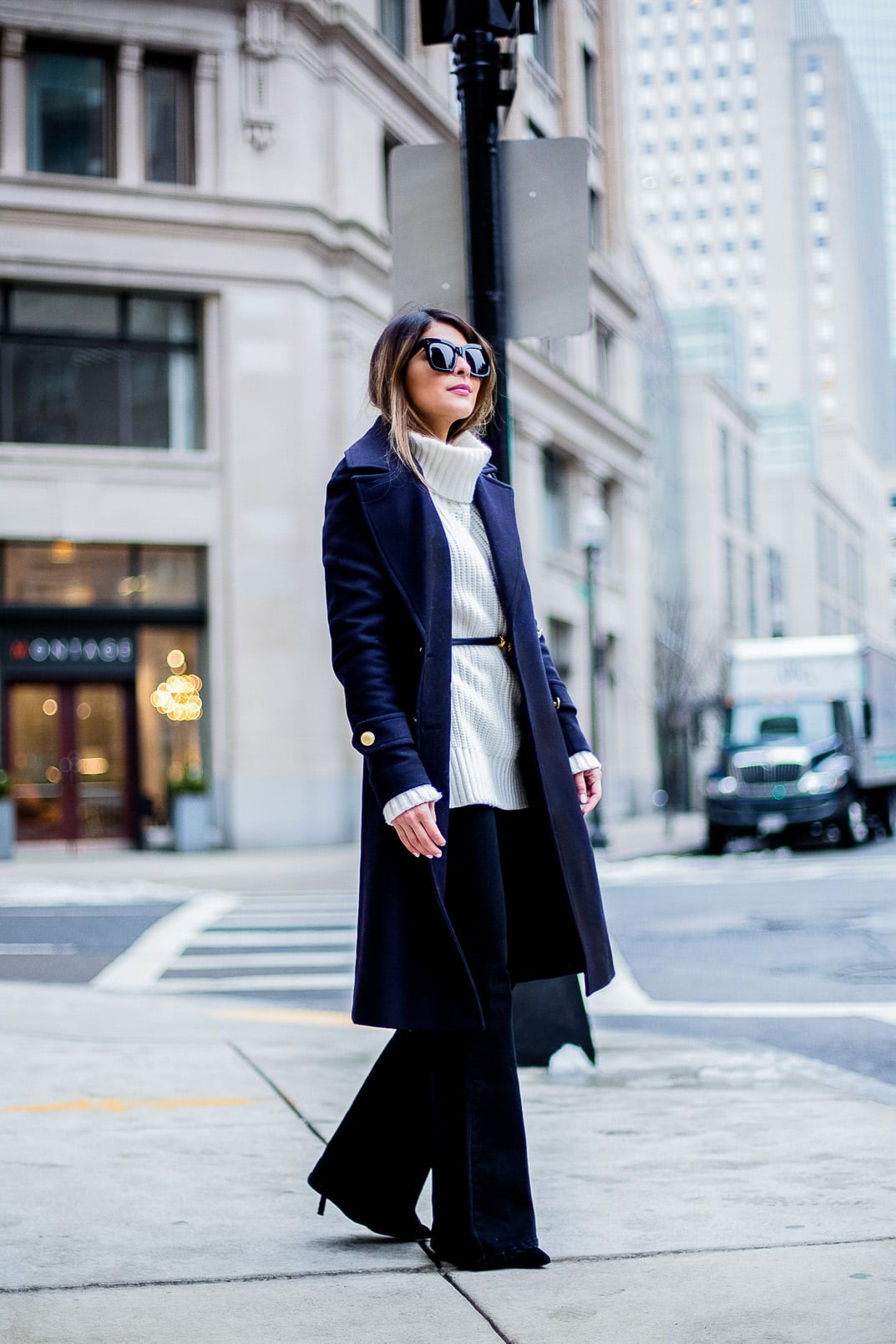Pam Hetlinger, The Girl From Panama wearing an h&m navy coat, celine sunglasses, thin belt, mango flare jeans, white turtleneck sweater and chloe georgia bag.