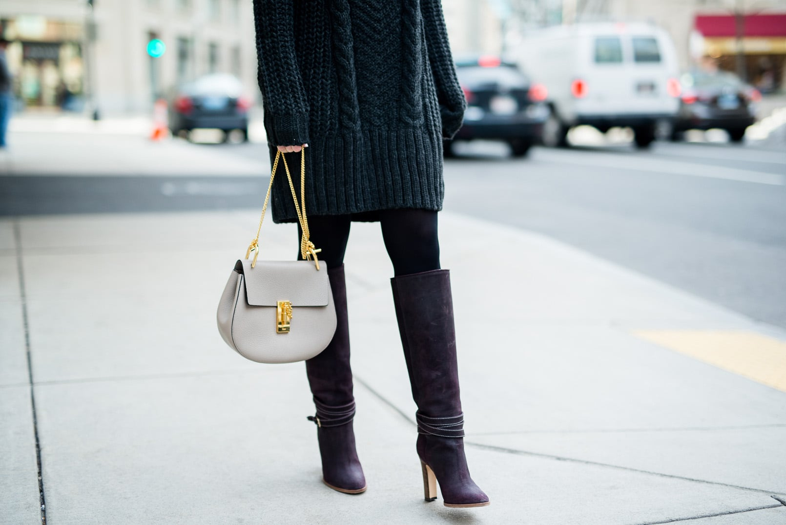 Pam Hetlinger wearing a h&m turtleneck sweater dress, club monaco buckle knee-high boot, celine sunglasses, grey chloe drew bag, and black tights