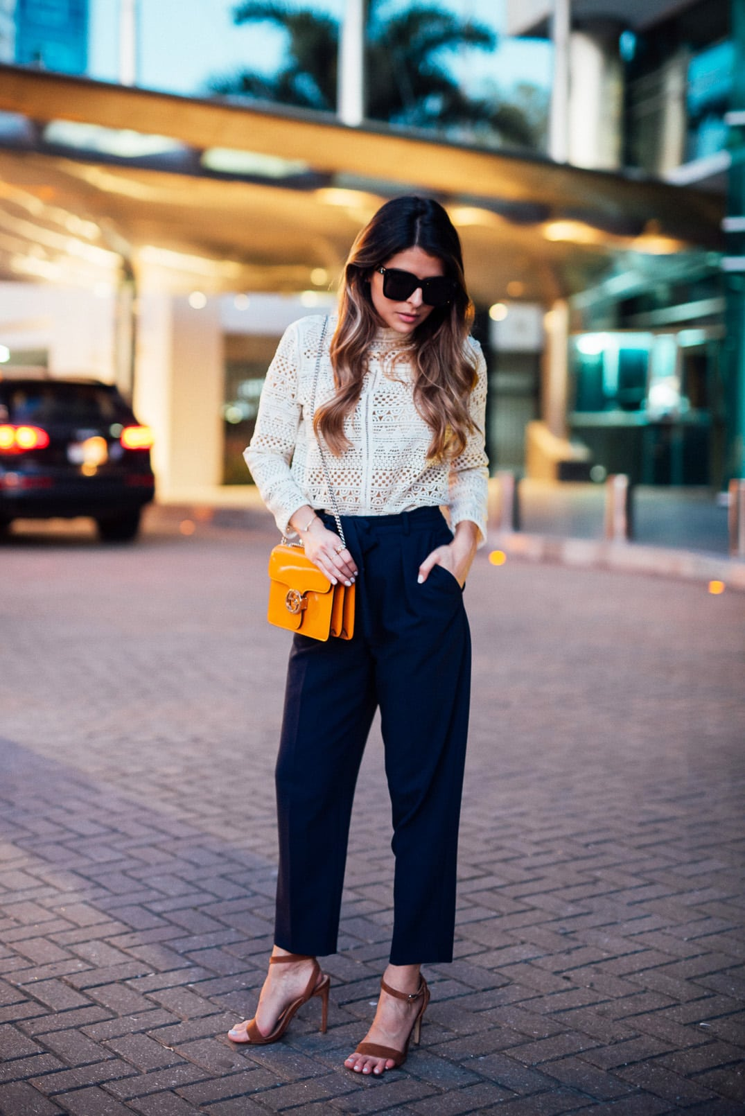 Pam Hetlinger, The Girl From Panama wearing a mango crochet top, high waist topshop navy pants, ankle strap sandals and a gucci interlocking bag