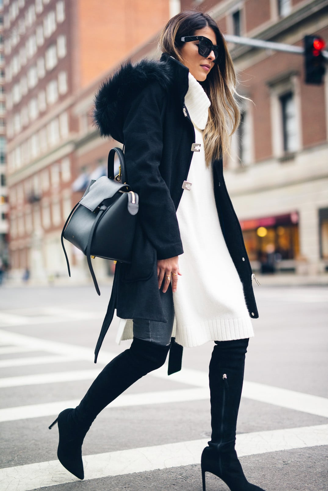 Pam Hetlinger, The Girl From Panama wearing Over-the-knee-boots, sleeveless tunic, gray denim, black coat, celine belt bag, and celine sunglasses