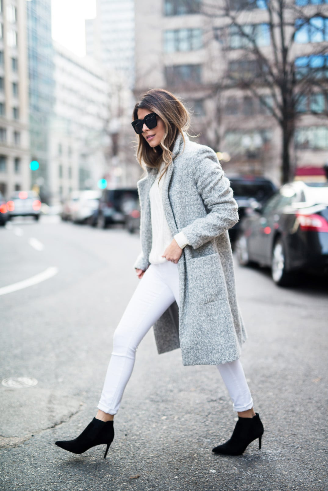 Pam Hetlinger, The Girl From Panama, wearing a Zac Posen Gray Coat, White Jeans, White Sweater, Black booties, Celine Sunglasses. The easiest way to style a gray coat.