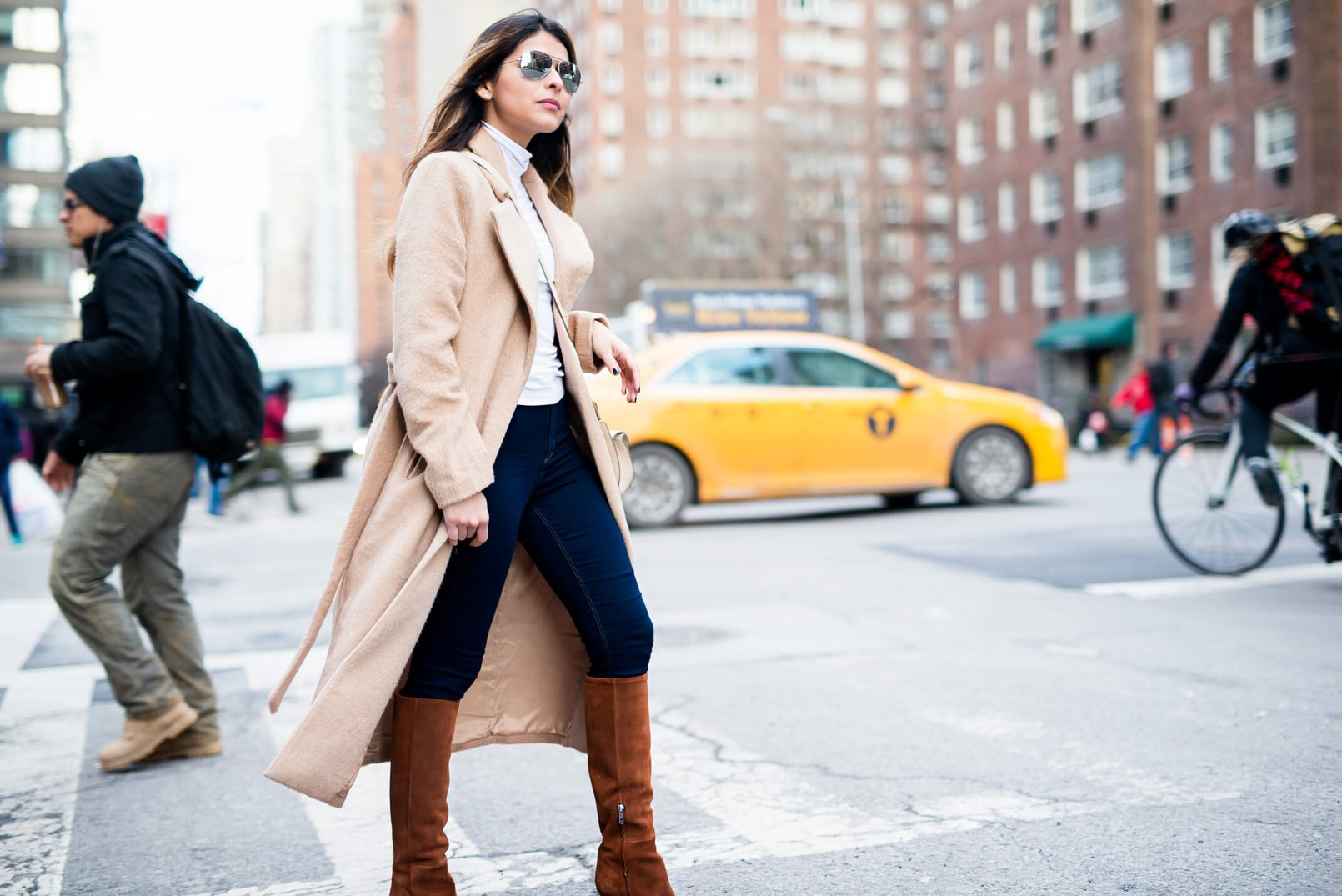 Pam Hetlinger wearing a missguided camel coat, chloe georgia bag, topshop high waisted pants, barbara bui knee-high brown boots, ray ban mirrored aviators, and asos turtleneck. new york city, fashion week.