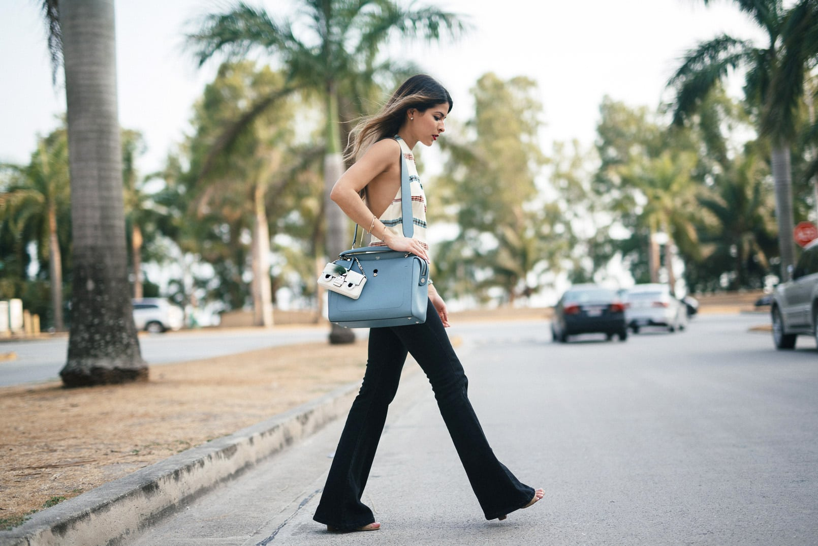 Pam Hetlinger, The Girl From Panama wearing an H&M Halter top, Mango Flare Jeans, Fendi DotCom bag, M.A.C Cosmetics velvetease lip pencil, and Fendi micro bag.