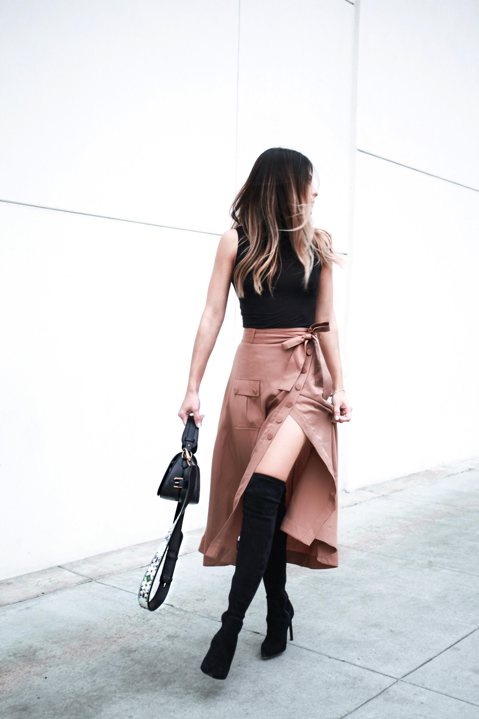 Pam Hetlinger wearing Over-the-knee boots, high slit skirt, sleeveless turtleneck. The Girl From Panama.