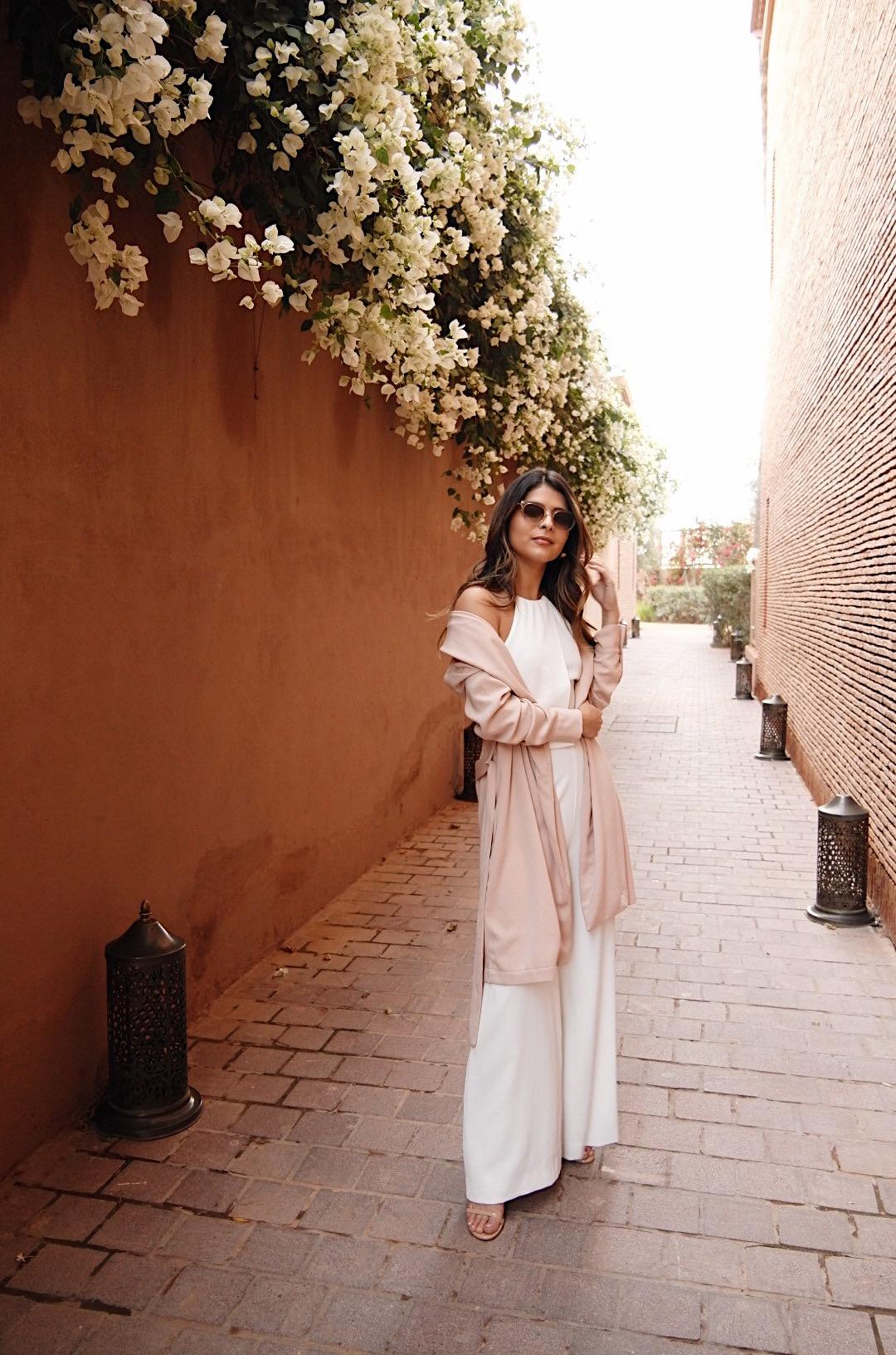 Pam Hetlinger wearing a white jumpsuit in Marrakech Morocco