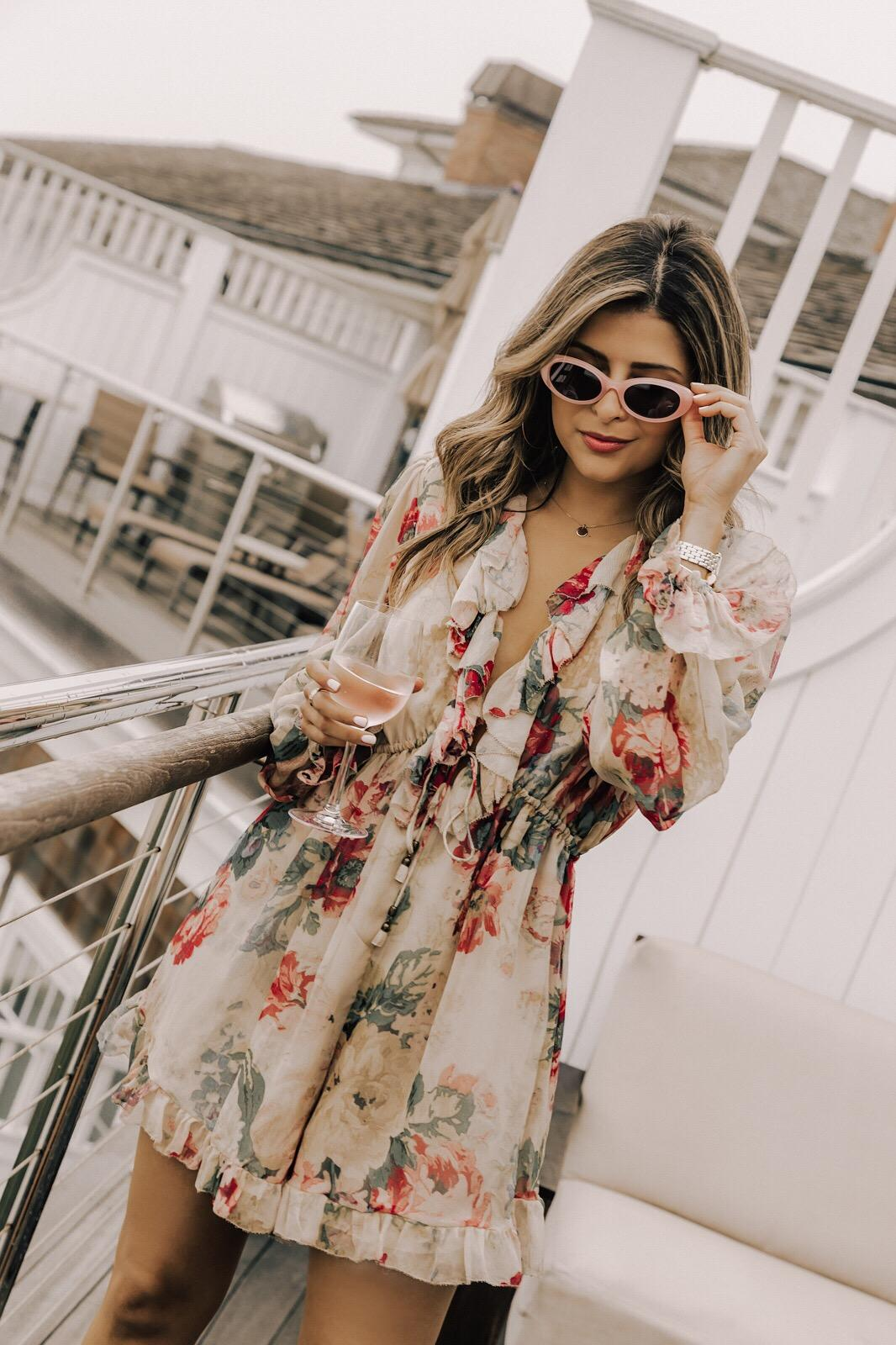 What to Wear to The Hamptons by Pam Hetlinger | Summer Fridays Hamptons Trip, Top LA Bloggers, Pam Hetlinger Style, Ruffle jumpsuit, oval sunglasses, Floral Ruffle Romper, Zimmerman Outfit, Chic Beach Look | TheGirlFromPanama.com