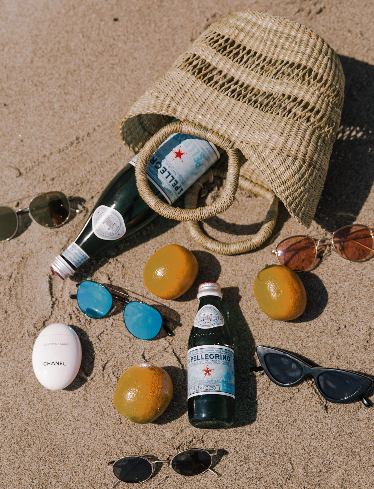 Sunglasses I Can't Stop Wearing This Summer by Pam Hetlinger | Beach Flatlay, sunglasses trends