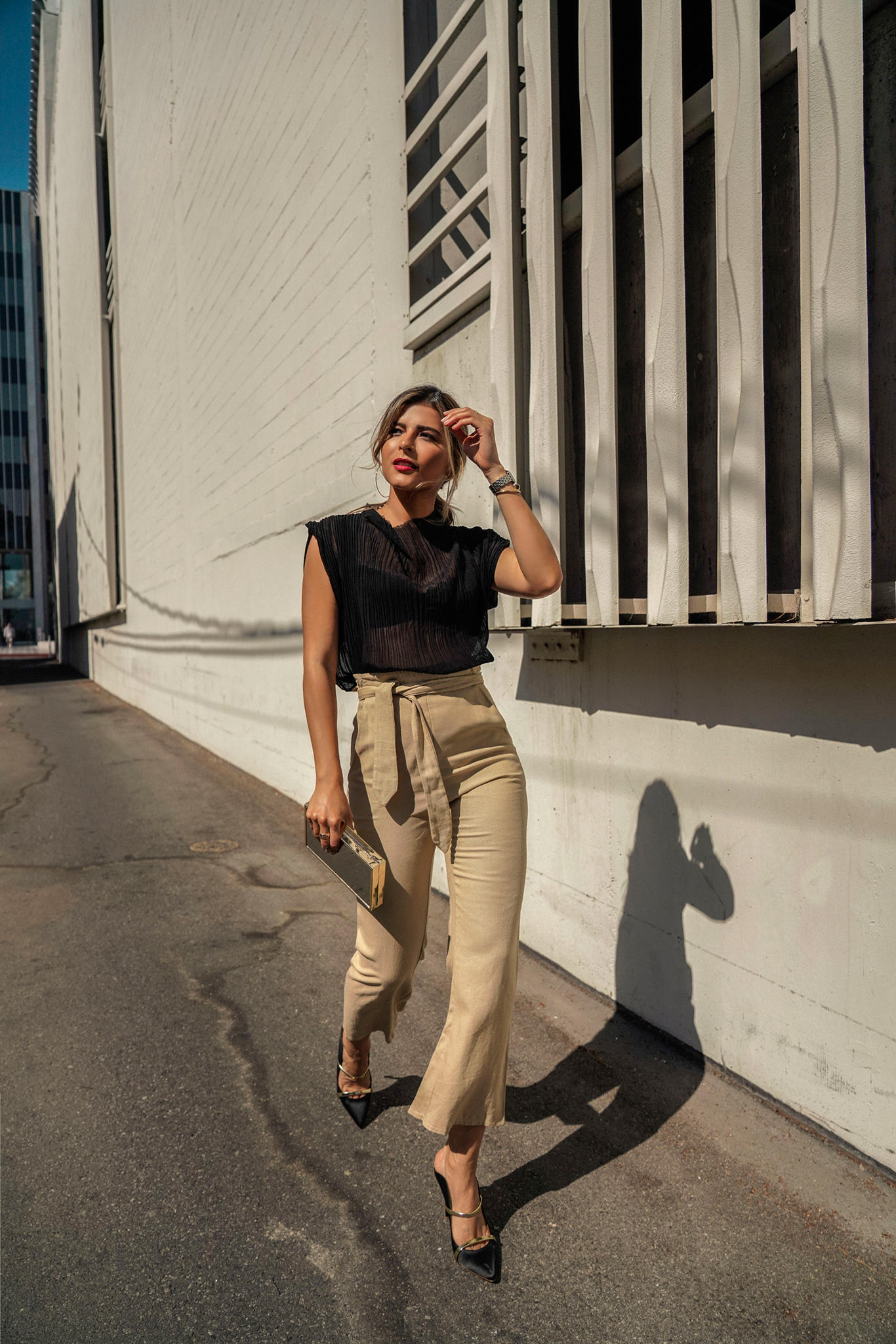 Chic Outfits That Never Go Out of Style by Pam Hetlinger | TheGirlFromPanama.com | Black Sheer Top, Sheer top outfit, tie waist trousers, chic weekend style, classy style