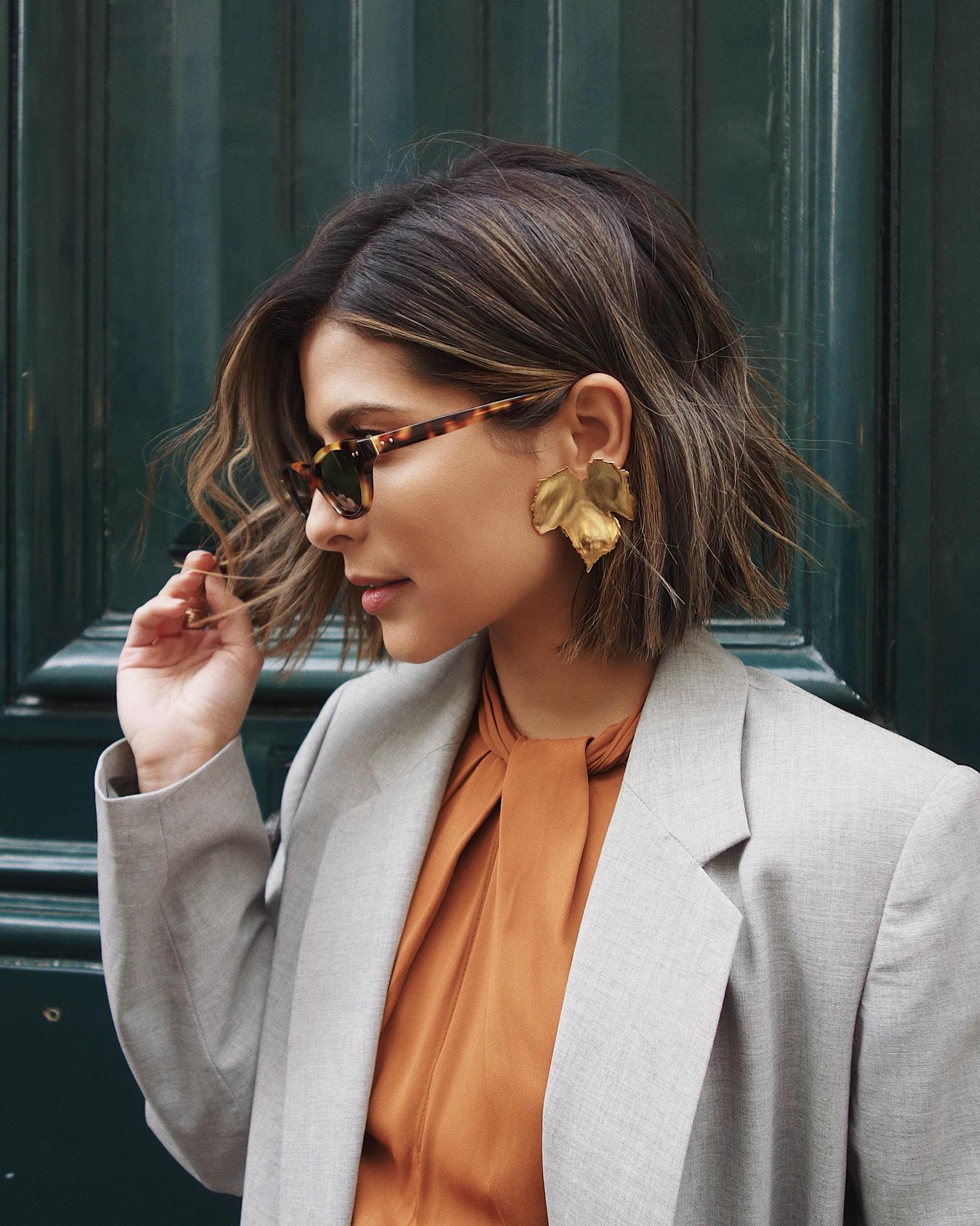 Paris Fashion Week FW19 Recap by Pam Hetlinger | TheGirlFromPanama.com | paris fashion week street style, fashion week spring 2019 street style, gold statement earrings, wavy lob hairstyle
